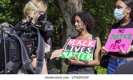 NEW YORK - JUNE 6, 2020: young Black activists being interviewed for television at Black Lives Matter rally in Washington Square Park New York City NYC.