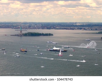 NEW YORK - JUNE 6: Space Shuttle Enterprise, on a barge and surrounded by boats, floats by the Statue Of Liberty in New York Harbor, June 6, 2012. The retired prototype Shuttle was bound for the Intrepid Museum.