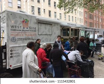 NEW YORK - JUNE 7, 2018: Mobile truck in Manhattan delivers food to people in need, hunger, hungry.  People volunteer to give out meals.