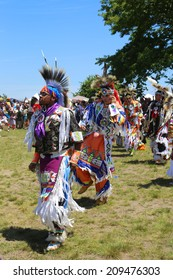 NEW YORK - JUNE 8: Unidentified Native American dancers at the NYC Pow Wow in Brooklyn on June 8, 2014. A pow-wow is a gathering and Heritage Celebration of North America s Native people