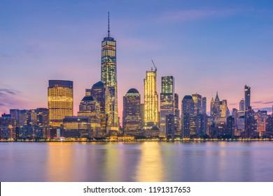 New York, Lower Manhattan Skyline from across the Hudson River at dawn.