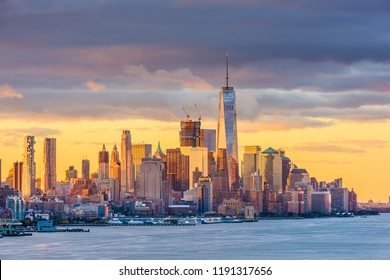 New York, Lower Manhattan Skyline from across the Hudson River at dawn.