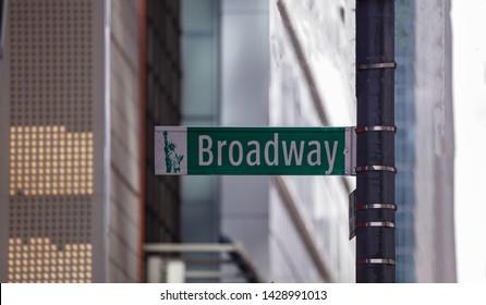 New york, Manhattan, downtown. Broadway street sign. Blur buildings facade background,