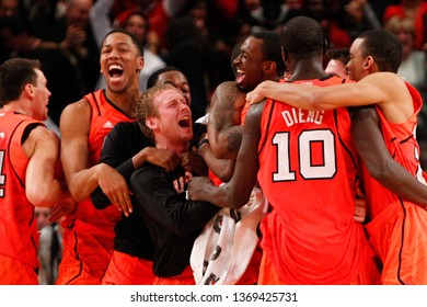 NEW YORK - MAR 10: Louisville Cardinals players celebrate after winning the Big East Tournament against the Cincinnati Bearcats on March 10, 2012 at Madison Square Garden in New York City.