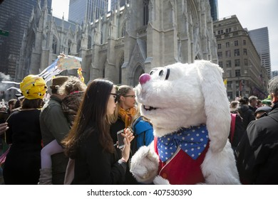 NEW YORK - MAR 27 2016: A person wearing a full Easter Bunny costume walks through the crowd along 5th Avenue on Easter Sunday for the traditional Easter Bonnet Parade in Manhattan on March 27, 2016.