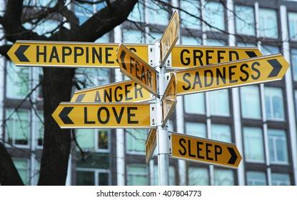 NEW YORK - MARCH 10, 2016: Signpost by by Australian-based artist Stuart Ringholt in First Street Park, Lower Manhattan