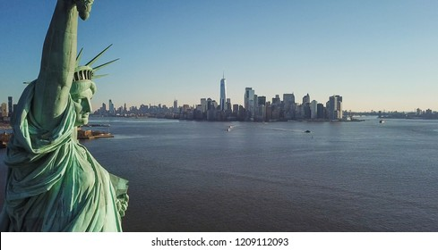 NEW YORK - MARCH 11, 2018: Statue of Liberty aerial with Manhattan skyline in background in NYC. The Statue of Liberty is a colossal sculpture on Liberty Island.