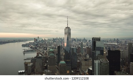 NEW YORK - MARCH 11, 2018: high aerial view of Freedom Tower on cloudy day in Manhattan NYC. The famous landmark skyscraper is the primary structure at the World Trade Center site in Lower Manhattan.
