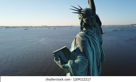NEW YORK - MARCH 11, 2018: rear view of Statue of Liberty from sky in NYC. The famous statue had 3.2 million visitors in 2009.