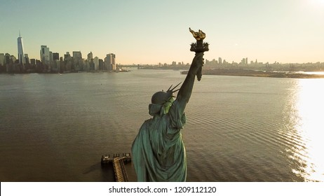 NEW YORK - MARCH 11, 2018: Statue of liberty aerial at golden sunset in NYC. The Statue of Liberty is a neoclassical sculpture on Liberty Island in New York Harbor.