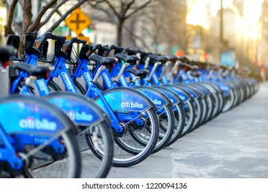 NEW YORK - MARCH 15, 2015: Row of Citi bike rental bicycles at docking station in New York City. Shared bikes lined up in the street of New York, USA.