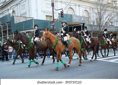 NEW YORK - MARCH 17, 2016: Young horseback riders participate at the St. Patrick's Day Parade in New York.
