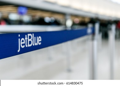 New York, March 18, 2017: Stanchion with the jetBlue signage on the band is seen at the jetBlue terminal of the JFK airport.