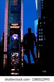 New York - March 29, 2007: Rear view of the statue of George M. Cohan in Duffy Square at dawn.