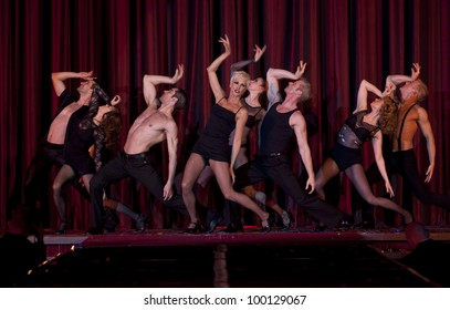 NEW YORK - MARCH 31: Amra Faye and cast of Chicago musical perform on stage at the 26th annual Night Of A Thousand Gowns at the Marriott Marquis Times Square on March 31, 2012 in New York City
