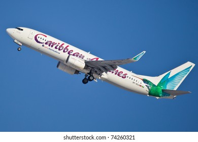 NEW YORK - MARCH 5: Boeing 737NG Caribbean climbs after take off from JFK airport located in New York, USA on March 5, 2011 Boeing 737NG New Generation is the newest version of B737 as of 2011