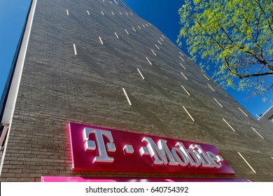 New York, May 08, 2017: Exterior sign on a wall over a T-Mobile retail store in Manhattan.