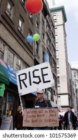 NEW YORK - MAY 1: A protester holds a sign with balloons during the march to Union Square from Bryant Park at Occupy Wall St 'May Day' protests on May 1, 2012 in New York, NY.