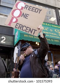NEW YORK - MAY 1: A protester holds a sign that reads 'Greedy One Percent' during the march to Union Square from Bryant Park at Occupy Wall St 'May Day' protests on May 1, 2012 in New York, NY.