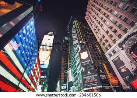 NEW YORK - MAY 12: Featured with Broadway Theaters, American flag on screen and animated LED signs, is a symbol of New York City and the United States, May 12, 2015 in Manhattan, New York City