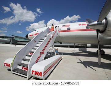 NEW YORK- MAY 16, 2019: TWA Hotel employees wear vintage uniform at newly opened hotel at the landmark TWA Flight Center building designed by Eero Saarinen at the JFK Airport (JFK) in New York