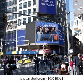 NEW YORK - MAY 18: Image of Facebook CEO Mark Zukerberg is flashed on a screen outside the Thomson Reuters building at the opening bell in Times Square on May 18, 2012 in New York City.