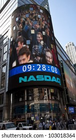 NEW YORK - MAY 18: Image of employees of Facebook is flashed on a screen outside the NASDAQ stock exchange at the opening bell in Times Square on May 18, 2012 in New York City.