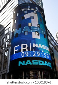 NEW YORK - MAY 18: Sign announcing 1 second before opening Facebook IPO is flashed on a screen outside the NASDAQ stock exchange at the opening bell in Times Square on May 18, 2012 in New York City.