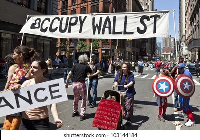 NEW YORK - MAY 19: Members of Occupy Wall Street movement perform on Broadway as part of New York Dance Parade on May 19, 2012 in New York City