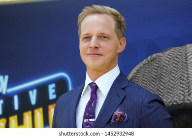"""NEW YORK - MAY 2, 2019: Chris Geere attends the premiere of """"Pokemon Detective Pikachu"""" in Times Square on May 2, 2019, in New York City."""