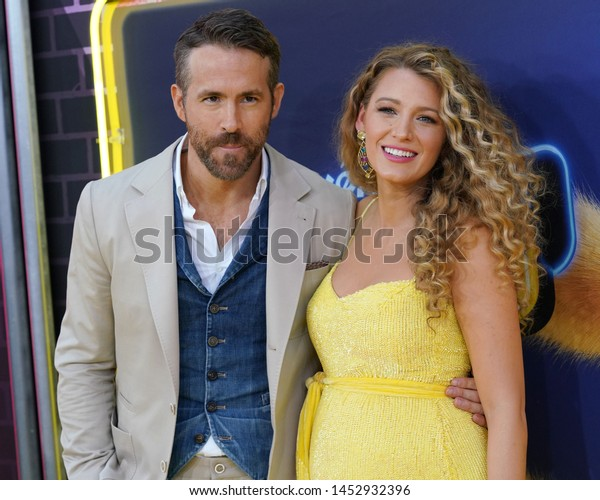 """NEW YORK - MAY 2, 2019: Ryan Reynolds and Blake Lively attend the premiere of """"Pokemon Detective Pikachu"""" in Times Square on May 2, 2019, in New York City."""