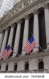 NEW YORK - MAY 2: U.S. Flags wave outside the New York Stock Exchange on May 2, 2011 in New York City. Osama bin Laden was killed in Pakistan by US Seals the day before.