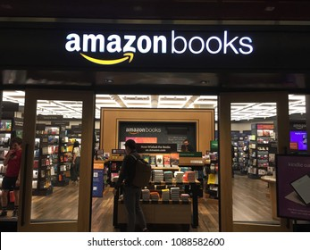NEW YORK- MAY 2018: Amazon Books is a chain of retail bookstores by online retailer. Shot is brick-and-mortar store in Time Warner Center. E-commerce biz sells Kindles, Fire TV tablet Alexa Echo AMZN