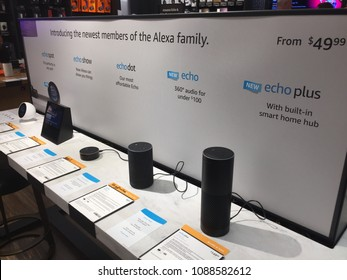 NEW YORK- MAY 2018: Amazon Echo family, Echo Spot, Show, Dot, Alexa Voice Service activated recognition system Amazon book store. E-commerce sells Kindles, Fire TV tablet Alexa Echo AMZN  smart home