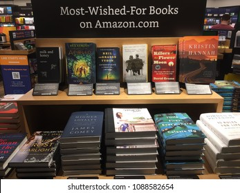 NEW YORK- MAY 2018: Amazon Fire family, Fire 7, HD 8, 7 Kids Edition, HD 8 Kids Edition inside Amazon book store. E-commerce biz sells Kindles, Fire TV tablet Alexa Echo AMZN