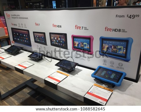 NEW YORK- MAY 2018: Amazon Fire family, Fire 7, HD 8, 7 Kids Edition, HD 8 Kids Edition inside Amazon book store. E-commerce biz sells Kindles, Fire TV tablet Alexa Echo AMZN