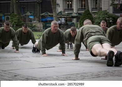 NEW YORK - MAY 21 2015: A group of US Marines doing push ups during an early morning boot camp exercise in Bryant Park at Marine Day during Fleet Week NY 2015.
