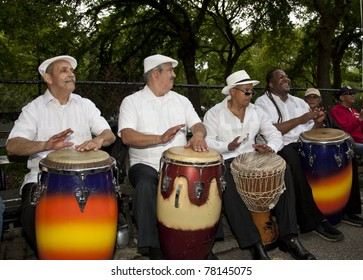 NEW YORK - MAY 21: Drummers of Los Salseros band perform in Tompkins Square park as part of New York Dance Parade on May 21, 2011 in New York City