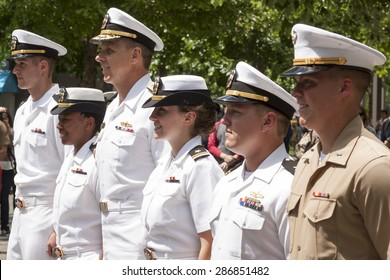 NEW YORK - MAY 22 2015: Participating US Navy and Marine Corps personnel stand at attention at the promotion ceremony at the National September 11 Memorial site during Fleet Week 2015.
