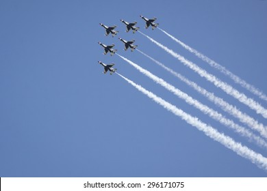NEW YORK - MAY 22 2015: US Air Force Thunderbird F-16 jets fly above Manhattan in a diamond formation with precision during Fleet Week NY 2015 as part of the Memorial Day celebrations.
