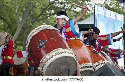 NEW YORK - MAY 22: Members of Japanese drum music groups NY Suwa Taiko Association & Soh Daiko perform as part of 5th annual Japan Day in Central Park on May 22, 2011 in New York City