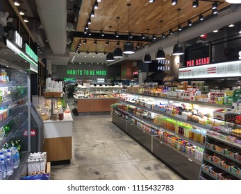 NEW YORK - MAY 23, 2018: Empty interior of health food store in Manhattan. Consumers shoppers seek healthy alternatives to fast food and processed meals.
