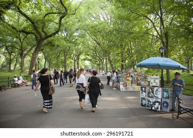 NEW YORK - May 25, 2015: People walking in Literary Walk, in Central Park, New York City. Central Park is an urban park in the central part of the borough of Manhattan with a  size of 843 acres.
