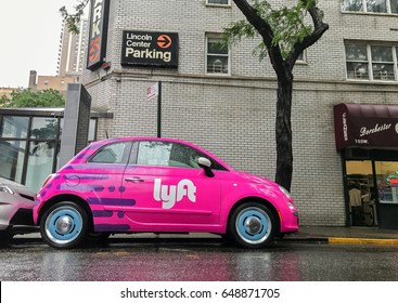 New York, May 25, 2017: Fiat 500 painted pink and carrying a Lyft logo is parked in the streets of Manhattan.