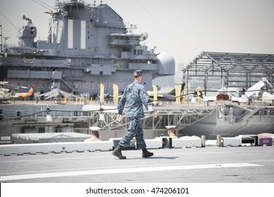NEW YORK MAY 26 2016: Military personnel on the flight deck of the USS Bataan (LDH 5) an amphibious assault ship moored at Pier 88 for Fleet Week NY 2016.