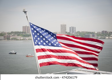 NEW YORK MAY 26 2016: The American Flag, the nations ensign, flying from the stern of the USS Bataan (LDH 5) an amphibious assault ship moored at Pier 88 for Fleet Week NY 2016.