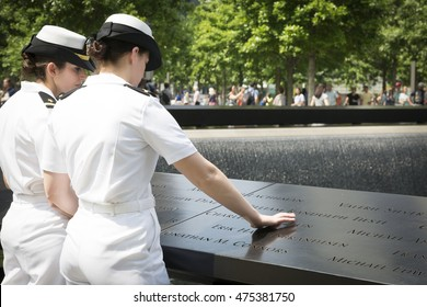 NEW YORK MAY 27 2016: US Navy personnel at the reflecting pools at One World Trade after the re-enlistment and promotion ceremony at the National September 11 Memorial site during Fleet Week 2016.