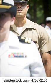 NEW YORK MAY 27 2016: Participating Marine Corps personnel stand at attention at the re-enlistment and promotion ceremony at the National September 11 Memorial site during Fleet Week 2016.