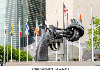NEW YORK - MAY 28: Non Violence Sculpture at the UN Headquarters in May 28, 2013. The in New York, New York. A Gun tied in a knot as symbol for reaching peace, gift from the Government of Luxembourg