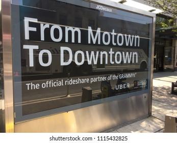 "NEW YORK - MAY 29, 2018: Uber app advertisement ride sharing, disruption, business model ""Uberification"" smartphones. Quantifying benefits vehicle car pooling shareability tranportation networks"